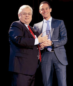 Richard Dixon, Vice President and Human Resources Officer of NAV CANADA, is presented the C.M. Hincks award by Peter Coleridge, CEO of the Canadian Mental Health Association at the 12th annual Bottom Line Conference, Tuesday, Feb. 24 at the Vancouver Convention Centre.