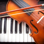 Violin on piano keyboard.